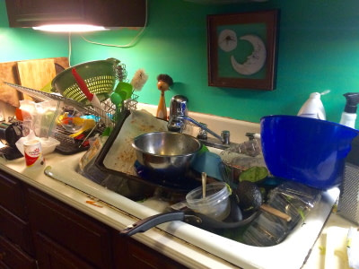 dirty dishes piling up in sink remind us of taking municipal water for granted