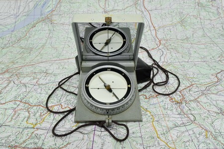 compass sitting atop a map