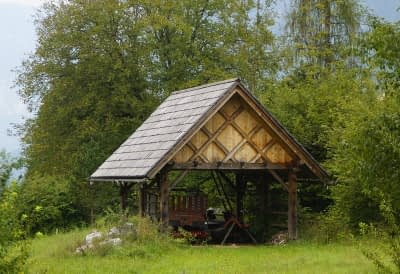 rustic farmhouse outbuilding in the trees