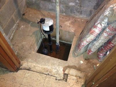 pedestal sump pump installed in basement sump hole