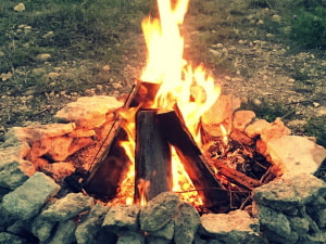 teepee campfire in rock ring