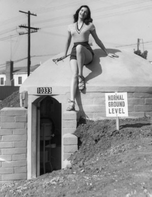 1950s underground bunker with vintage model posing
