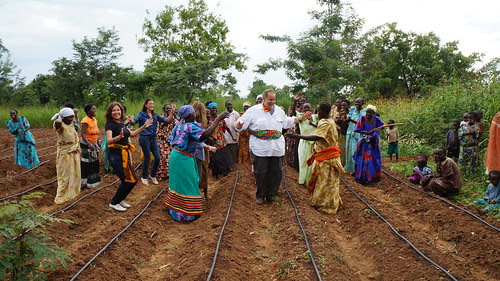 villagers celebrating solar powered drip irrigation system